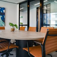 board room table with brown leather chairs