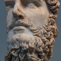 A stone bust of Zues